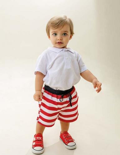 Joaquim (agência: O Armário de Sophie) veste shorts R$69,99 e polo R$45,99 Hering Kids | tênis All Star R$138,90 Bunny Ears